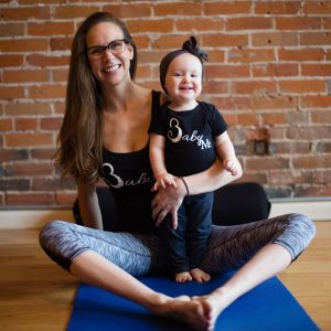Mother and Daughter smiling in yoga